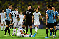 BUCARAMANGA – COLOMBIA, 03-02-2020: Kevin Ortega (PER), arbitro, durante partido entre Argentina U-23 y Uruguay U-23 por el cuadrangular final como parte del torneo CONMEBOL Preolímpico Colombia 2020 jugado en el estadio Alfonso Lopez en Bucaramanga, Colombia. / Kevin Ortega (PER), referee, during the match between Argentina U-23 and Uruguay U-23 for for the final quadrangular as part of CONMEBOL Pre-Olympic Tournament Colombia 2020 played at Alfonso Lopez stadium in Bucaramanga, Colombia. Photo: VizzorImage / Julian Medina / Cont