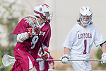 Los Angeles, CA 02/17/14 - Scott Wheaton (Santa Clara #8) and Brad Chestnut (LMU #1) in action during the Santa Clara University - Loyola Marymount University MCLA's Men's lacrosse game at Loyola Marymount University.  Santa Clara defeated LMU 11-10 in overtime.