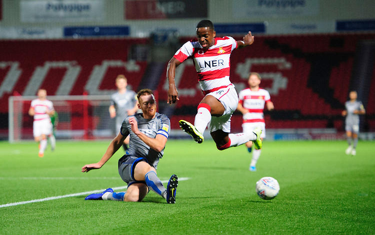 Doncaster Rovers' Cameron John is tackled by Lincoln City's Cian Bolger<br /> <br /> Photographer Chris Vaughan/CameraSport<br /> <br /> EFL Leasing.com Trophy - Northern Section - Group H - Doncaster Rovers v Lincoln City - Tuesday 3rd September 2019 - Keepmoat Stadium - Doncaster<br />  <br /> World Copyright © 2018 CameraSport. All rights reserved. 43 Linden Ave. Countesthorpe. Leicester. England. LE8 5PG - Tel: +44 (0) 116 277 4147 - admin@camerasport.com - www.camerasport.com