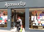 Accessorise shop shoppers entering from street, Tavern Street, Ipswich, Suffolk, England, UK