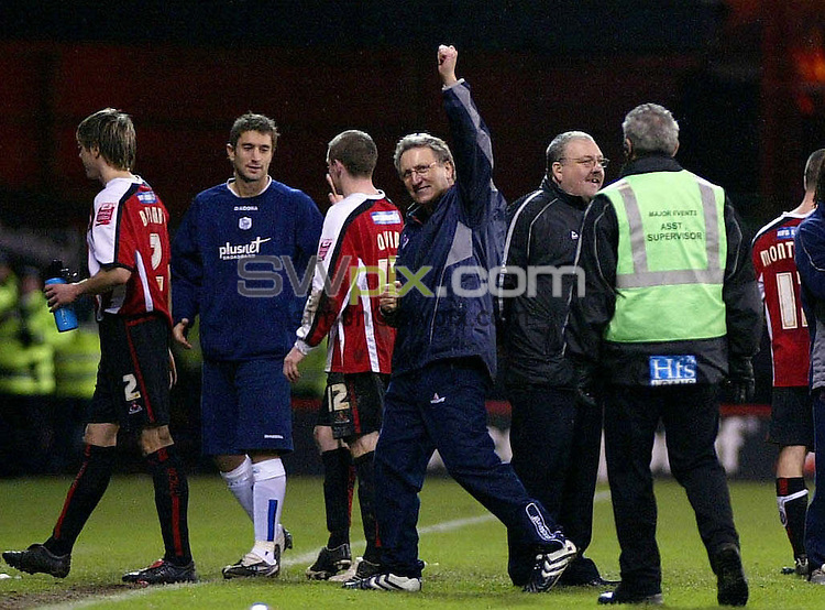 Pix, Shaun Flannery/SWpix. Coca-Cola League Championship. Sheffield United v Sheffield Wednesday, 3.12.05...COPYRIGHT PICTURE>>SIMON WILKINSON>>01943 - 608782>>..United Manager Neil Warnock celebrates victory.