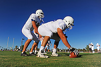 Sept. 16, 2009; Casa Grande, AZ, USA; California Redwoods center (67) Matt Lentz prepares to hike the ball to quarterback (15) Brett Dietz during training camp at the Casa Grande Training Facility & Performance Institute. Mandatory Credit: Mark J. Rebilas-