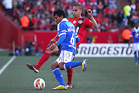 TIJUANA -MEXICO, 10-04-2013. Jorge Hernandez (D) del Tijuana y Luis Mosquera (I)  de Millonarios durante el juego de la fase de grupos de la Copa Libertadores 2013 en el Estadio Caliente en Tijuana, Mexico./  Jorge Hernandez (l) of Tijuana and  Luis Mosquera (r) of Millonarios fights for tha ball during match of the groups stage of Libertadores Cup 2013 at Caliente stadium in Tijuana, Mexico.  Photo: Gonzalo Gonzalez /JAM MEDIA/VizzorImage