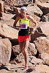 August 15, 2015 - Manitou Springs, Colorado, U.S. - Evergreen, Colorado runner, Brandy Erholtz, reaches for thin and precious oxygen as she works her way through the final steep and rocky pitch on her way to a 2nd place finish in a time of 2:51:38 during the 60th running of the Pikes Peak Ascent.  During the Ascent, runners cover 13.3 miles and gain more than 7815 feet (2382m) by the time they reach the 14,115ft (4302m) summit.  On the second day of race weekend, 800 marathoners will make the round trip and cover 26.6 miles of high altitude and very difficult terrain in Pike National Forest, Manitou Springs, CO.