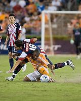 CD Guadalajara midfielder Edgar Solis (16) goes over the top of Houston Dynamo midfielder Corey Ashe (26).  CD Guadalajara defeated Houston Dynamo 1-0 during the group stage of the Superliga 2008 tournament at Robertson Stadium in Houston, TX on July 15, 2008.