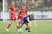Portland, OR - Saturday July 30, 2016: Emily Menges, Kim Little during a regular season National Women's Soccer League (NWSL) match between the Portland Thorns FC and Seattle Reign FC at Providence Park.