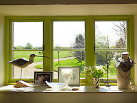 Amongst the interesting objects on this window sill, with its views to the extensive garden beyond, is some jewellery designed by Monica Vinader