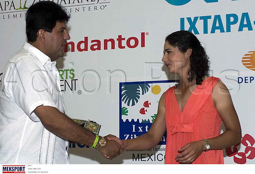 Lorena Ochoa (MEX), JUNE 19, 2009 - Golf : Lorena Ochoa of Mexico and Alejandro Bravo (R) attend the press conference before the tournament Skins 2009 at Palma Real Golf Club in Guerrero, Ixtapa, Mexico. (Photo by MEXSPORT/ActionPlus) UK Lincenses Only
