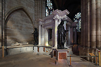 Tomb of Henri II, 1519–59, and Catherine de Medici, 1519–89, with statues of the virtues, in the Basilique Saint-Denis, Paris, France. The funerary monument was made 1560-73 by Francesco Primaticcio, Jacquio Ponce and Germain Pilon. On the left is the effigy of Guillaume du Chastel, d. 1441, pantler to king Charles VII who commissionned this statue, in stone with a marble face. The basilica is a large medieval 12th century Gothic abbey church and burial site of French kings from 10th - 18th centuries. Picture by Manuel Cohen