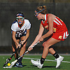Courtney Kennedy #11 of Cold Spring Harbor, left, and Maggie Mahon #28 of Sacred Heart battle for a loose ball during a non-league varsity girls lacrosse game at Cold Spring Harbor High School on Friday, Apr. 1, 2016. Cold Spring Harbor won by a score of 11-9.