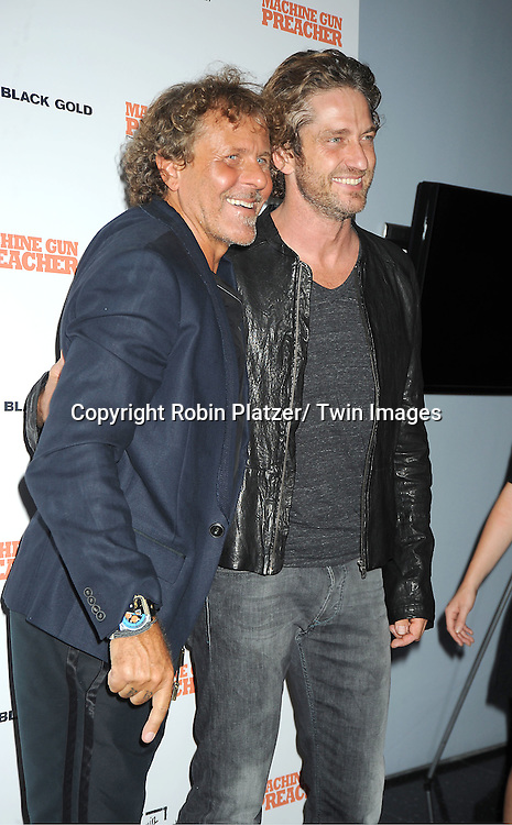 "Renzo Russo and Gerard Butler attending a special screening of ""Machine Gun Preacher"" at the Museum of Modern Art on September 13, 2011 in New York City. The movie stars Gerard Butler and Michelle Monaghan.."