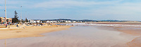 Panoramic photo of Essaouira beach on the coast of Morocco, North Africa, Africa. This panoramic photo shows Essaouira beach, which despite being absolutely vast, is not one of the main reasons for visiting the coastal town of Essaouira (formerly Mogador).