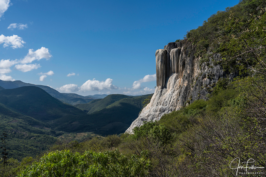 Stalactities of Cascada Grande or the Big Waterfall mineral formation at Hierve el Agua, near Mitla, Mexico.  Behind are the Sierra Madre del Sur Mountains.