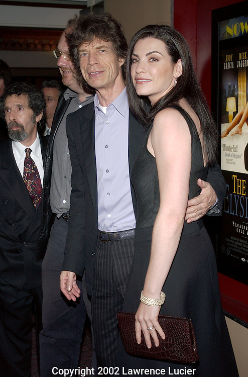 NEW YORK-SEPTEMBER 29: Recording artist Mick Jagger and actress Julianna Margulies arrives at the premier of the film The Man from Elysian Fields September 29, 2002, in New York City.