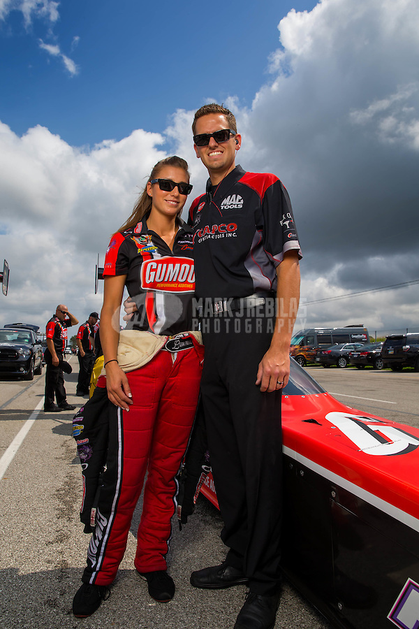 Aug 31, 2014; Clermont, IN, USA; NHRA top fuel dragster driver Leah Pritchett (left) with husband Gary Pritchett during qualifying for the US Nationals at Lucas Oil Raceway. Mandatory Credit: Mark J. Rebilas-USA TODAY Sports