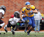 BROOKINGS, SD - OCTOBER 5:  Zach Zenner #31 from South Dakota State University slips past the grasp of Carl Bivens #43 from Southern Illinois in the first quarter Saturday afternoon at Coughlin Alumni Stadium in Brookings. (Photo by Dave Eggen/Inertia)