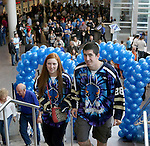 SIOUX FALLS, SD - MAY 15: Josie Gum, left,  from Sioux Falls, and David Rutherford, from Brookings, shows their Stampede pride walking into the Denny Sanford Premier Center prior to game three Friday night.  (Photo by Dave Eggen/Inertia)