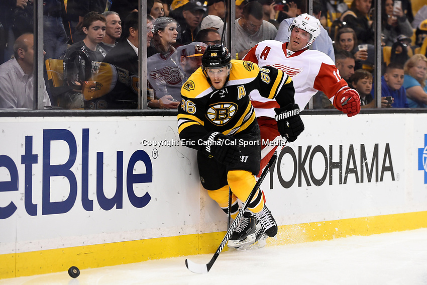 Monday, September 28, 2015, Boston, MA - Boston Bruins defenseman Kevan Miller (86) checks Detroit Red Wings right wing Daniel Cleary (11) and heads for the puck during the NHL game between the Detroit Red Wings and the Boston Bruins held at TD Garden, in Boston, Massachusetts. Detroit defeats Boston 3-1 in regulation time. Eric Canha/CSM