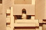 A hidden womans face behind blocks