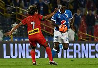 BOGOTA - COLOMBIA - 09 – 05 - 2017: Duvier Riascos (Der.) jugador de Millonarios disputa el balón con Diego Chica (Izq.) jugador de Cortulua, durante partido de la fecha 17 entre Millonarios y por la Liga Aguila I-2017, jugado en el estadio Nemesio Camacho El Campin de la ciudad de Bogota. / Duvier Riascos (R) player of Millonarios vies for the ball with Diego Chica (L) player of Cortulua, during a match of the date 17th between Millonarios and Cortulua, for the Liga Aguila I-2017 played at the Nemesio Camacho El Campin Stadium in Bogota city, Photo: VizzorImage / Luis Ramirez / Staff.