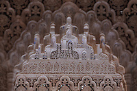 Polychrome mocarabe work in the Court of the Lions, built 1362 in the second reign of Muhammad V, in the Nasrid dynasty Palace of the Lions, Alhambra Palace, Granada, Andalusia, Southern Spain. The Alhambra was begun in the 11th century as a castle, and in the 13th and 14th centuries served as the royal palace of the Nasrid sultans. The huge complex contains the Alcazaba, Nasrid palaces, gardens and Generalife. Picture by Manuel Cohen