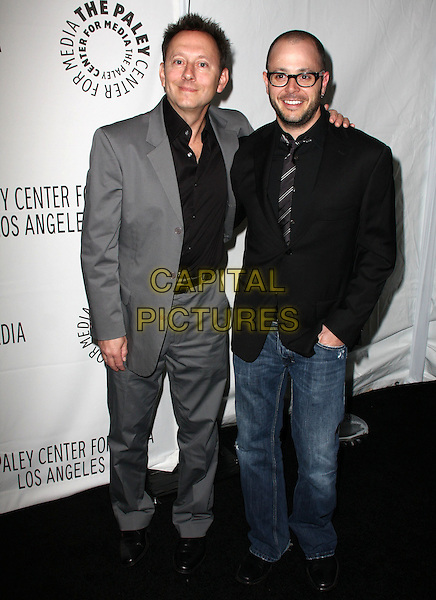 MICHAEL EMERSON & DAMON LINDELOF.27th Annual PaleyFest Presents the television show 'Lost' held At The Saban Theatre, Beverly Hills, California, USA, 27th February 2010..arrivals full length jacket jeans blazer hand in pocket black tie glasses beard facial hair shirt grey gray suit shirt .CAP/ADM/KB.©Kevan Brooks/Admedia/Capital Pictures