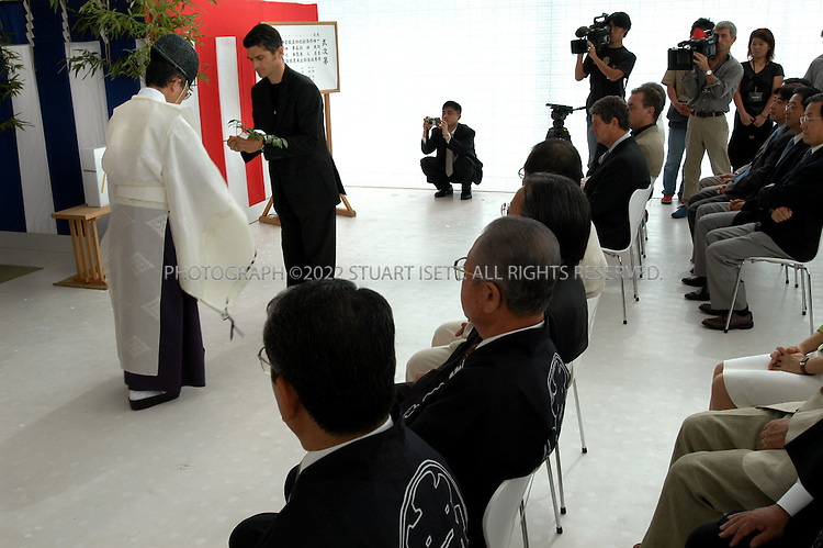 September 1, 2002, Tokyo, Japan: Officials from Louis Vuitton partake in a Shinto ceremony to bless the opening of the world's largest Louis Vuitton store on Omotesando Avenue in Tokyo, Japan, Sunday morning. The French luxury brand inaugurated the 3,300-square meter  in the total floor space, including an exhibition room for its historic products and a hall for meetings on Sunday. Despite a decade long economic slump, luxury designers have seen double digit growth in Japan where consumers are eager to embrace brand name products. Over 3000 people waited in line in sweltering 33 degree heat for the first day of opening including some who waited for 3 days...All photographs ©2003 Stuart Isett.All rights reserved.This image may not be reproduced without expressed written permission from Stuart Isett.