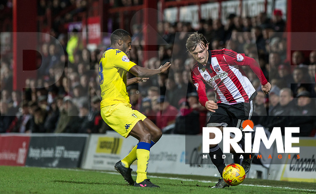 John Swift of Brentford turns Mustapha Carayol of Leeds United during the Sky Bet Championship match between Brentford and Leeds United at Griffin Park, London, England on 26 January 2016. Photo by Andy Rowland / PRiME Media Images.