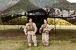 October 22, 2014. Camp LeJeune, North Carolina.<br />  Cpl. Allison DeVries, age 21, left, and LCpl. Vicki Harris, age 20, are Marines in artillery Battery A of the Ground Combat Element Integrated Task Force. The two Marines have the MOS of field artillery cannoneer (0811), a job previously closed to women.<br />  The Ground Combat Element Integrated Task Force is a battalion level unit created in an effort to assess Marines in a series of physical and medical tests to establish baseline standards as the Corps analyze the best way to possibly integrate female Marines into combat arms occupational specialities, such as infantry personnel, for which they were previously not eligible. The unit will be comprised of approx. 650 Marines in total, with about 400 of those being volunteers, both male and female. <br />  Jeremy M. Lange for the Wall Street Journal<br /> COED