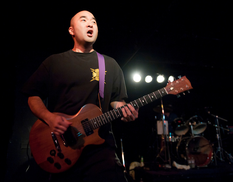 UNITED STATES - AUGUST 20: Kenny Inouye, son of Sen. Daniel Inouye, D-Hawaii, and guitarist for DC hardcore punk band Marginal Man in the 1980's, plays with the band during a reunion show at the Black Cat in Washington on Saturday, Aug. 20, 2011. (Photo By Bill Clark/Roll Call)