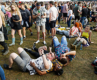 Pictured: Three men lie on the grass. Saturday 26 May 2018<br /> Re: BBC Radio 1 Biggest Weekend at Singleton Park in Swansea, Wales, UK.