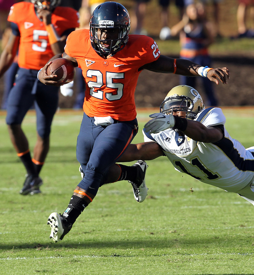 Oct. 15, 2011-Charlottesville, VA.-USA - Virginia Cavaliers running back Kevin Parks (25) runs past Georgia Tech linebacker Brandon Watts (11) during an ACC football game at Scott Stadium. Virginia won 24-21. (Credit Image: © Andrew Shurtleff