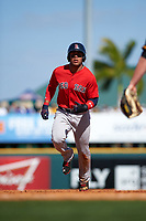 Boston Red Sox second baseman Yoan Moncada (22) running the bases during a Spring Training game against the Pittsburgh Pirates on March 9, 2016 at McKechnie Field in Bradenton, Florida.  Boston defeated Pittsburgh 6-2.  (Mike Janes/Four Seam Images)