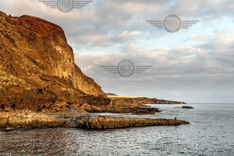 The rocky coastline near Tacoron. /Felix Features