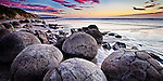 As the tide recedes a new day dawns over the barrier of boulders at Moeraki..This New Zealand Fine Art Landscape Print, available in four sizes on either archival Hahnemuhle Fine Art Pearl paper or canvas, is printed using Epson K3 Ultrachrome inks and comes with a lifetime guarantee against fading..All prints are signed and numbered on the lower margin and come with my 100% money back guarantee on the purchase price, should you not be  completely happy with the quality of the delivered print or canvas.