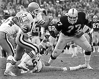 Oakland Raiders #77 Charles Philyaw ready to hit Cleveland QB Brian Sipe. (1979 photo/Ron Riesterer)