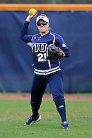11 February 2012:  FIU's Lindsey Menezes (21) throws from the outfield during pre-game drills as the University of Louisville Cardinals defeated the FIU Golden Panthers, 4-2, as part of the COMBAT Classic at the FIU Softball Complex in Miami, Florida.