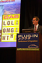 Jonathan Lauckner, Vice President, Global Program Management, General Motors Corporation (GM) giving a speech and showing funny high gas price graphics. The speech was held on the opening day of the July 22-24 inaugural Plug-In 2008 Conference & Exposition: A Short Drive to Tomorrow in San Jose, CA. The event showcases the latest technological advances, market research and policy initiatives shaping the future of plug-in hybrid electric vehicles (PHEVs). San Jose, California, USA