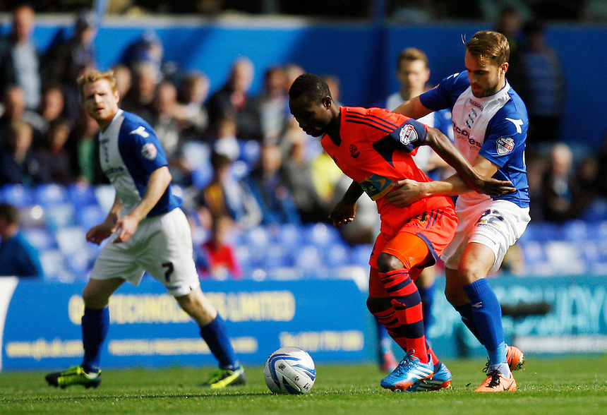 Bolton Wanderers' Medo Kamara (L) and Birmingham City's Andy Shinnie in action during todays match  <br /> <br /> Photo by Jack Phillips/CameraSport<br /> <br /> Football - The Football League Sky Bet Championship - Birmingham City v Bolton Wanderers -  Saturday 5th October 2013 - St Andrew's - Birmingham<br /> <br /> &copy; CameraSport - 43 Linden Ave. Countesthorpe. Leicester. England. LE8 5PG - Tel: +44 (0) 116 277 4147 - admin@camerasport.com - www.camerasport.com