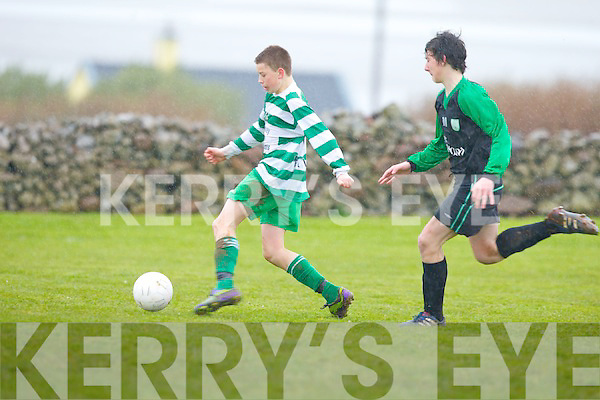 Fenit Samphires Gary Hanafin and Killarney Celtic's Shane Cronin...