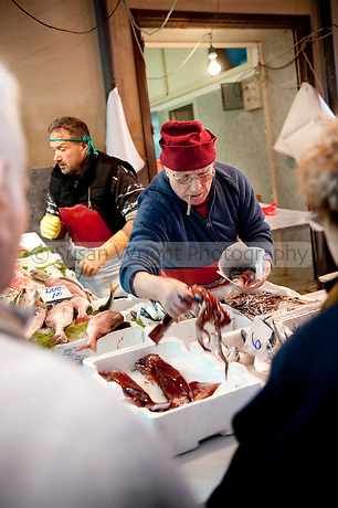 Vendor selling fresh fish at popular fresh produce market, 'Il Capo', in the historic quarter of 'Capo', Palermo, Sicily, Italy