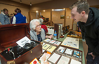 NWA Democrat-Gazette/BEN GOFF @NWABENGOFF<br /> Mary Vaughan of Springdale talks to Austin Larey of Little Rock about her collection of amateur radio equipment and QSL cards, most of which were collected her husband Bruce Vaughan, Saturday, Jan. 12, 2019, during the annual collectors day 'Cabin Fever Reliever' at the Shiloh Museum of Ozark History in Springdale. Dozens of local collectors set up tables showcasing their collections of such various things as kitchen utensils, coins, buttons, hand fans, fossils woodcarving and much more.