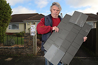 BNPS.co.uk (01202 558833)<br /> Pic: CorinMesser/BNPS<br /> <br /> Mike Bird with piece of someone's shed roof which ended up hitting his car.<br /> <br /> Homeowners are counting the cost today after a 'tornado' hit a south coast town overnight.<br /> <br /> Residents in Barton-on-Sea, Hants, were woken at 4am as the twister blasted its way through the town like an 'express train'. <br /> <br /> The strength of the winds of up to 80mph shook numerous houses, sending roof tiles smashing to the ground.<br />  <br /> A 30ft long brick wall collapsed under the strength of the gusts while fence panels were flung through the air.<br /> <br /> Part of a garden shed that had been picked up by the tornado smashed a hole through the windscreen of a car.