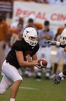 01 APRIL 2006: University of Texas freshman quarterback hopeful, Jevan Snead (left), prepares to hand off the ball at Darrell K. Royal Memorial Stadium during the Longhorns annual spring Orange vs White Scrimmage.