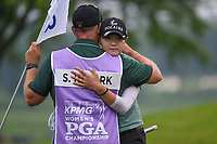 Sung Hyun Park (KOR) hugs her caddie after sinking her birdie putt on 18 during round 4 of the KPMG Women's PGA Championship, Hazeltine National, Chaska, Minnesota, USA. 6/23/2019.<br /> Picture: Golffile | Ken Murray<br /> <br /> <br /> All photo usage must carry mandatory copyright credit (© Golffile | Ken Murray)