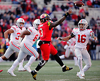 Maryland Terrapins quarterback Tyrrell Pigrome (3) throws the ball against Ohio State Buckeyes linebacker Keandre Jones (16) during the 3rd quarter of their game at Capital One Field at Maryland Stadium in College Park, Maryland on November 17, 2018. [Kyle Robertson/Dispatch]