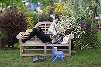 Monday 26 May 2014, Hay on Wye, UK<br /> Pictured: A man resting on a bench reading the Daily Telegraph newspaper.<br /> Re: The Hay Festival, Hay on Wye, Powys, Wales UK.