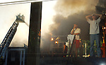 ATO fraternity members watch their fraternity house burn at the University of Mississippi on Friday, August 27, 2004. Three students died in the fire.