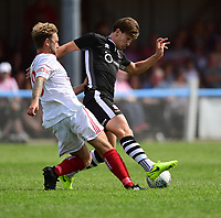 Lincoln City's Alex Woodyard vies for possession with Lincoln United's Rob Norris<br /> <br /> Photographer Chris Vaughan/CameraSport<br /> <br /> Football - Pre-Season Friendly - Lincoln United v Lincoln City - Saturday 8th July 2017 - Sun Hat Villas Stadium - Lincoln<br /> <br /> World Copyright &copy; 2017 CameraSport. All rights reserved. 43 Linden Ave. Countesthorpe. Leicester. England. LE8 5PG - Tel: +44 (0) 116 277 4147 - admin@camerasport.com - www.camerasport.com
