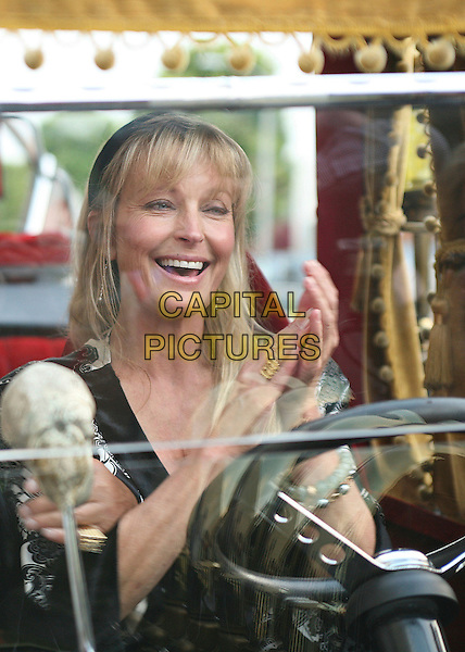 BO DEREK in the Munster's Koach.Friars of Beverly Hills Present Lifetime Achievement Award to George Barris, Beverly Hills, California, USA,.17 June 2006..half length hairband head hair band black clapping hands.Ref: ADM/BP.www.capitalpictures.com.sales@capitalpictures.com.©Byron Purvis/AdMedia/Capital Pictures.